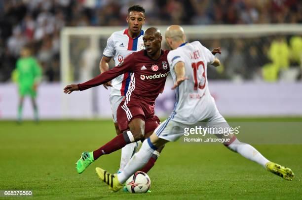 Corentin Tolisso of Lyon Atiba Hutchinson of Besiktas Christophe Jallet of Lyon during the Uefa Europa League quarter final first leg match between...