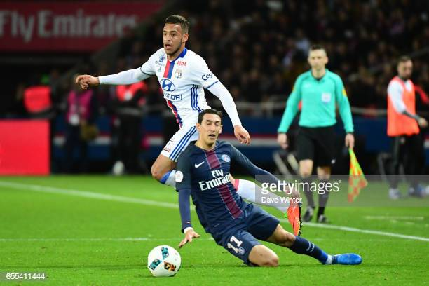 Corentin Tolisso of Lyon beats Angel Di Maria of PSG during the French Ligue 1 match between Paris Saint Germain and Lyon at Parc des Princes on...