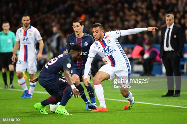 Corentin Tolisso of Lyon takes on Serge Aurier of PSG during the French Ligue 1 match between Paris Saint Germain and Lyon at Parc des Princes on...