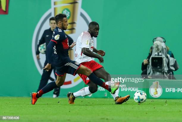 Corentin Tolisso of Muenchen and Dayot Upamecano of Leipzig battle for the ball during the DFB Cup round 2 match between RB Leipzig and Bayern...