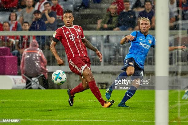 Corentin Tolisso of Muenchen and Kevin Kampl of Leverkusen Aktion battle for the ball during the Bundesliga match between FC Bayern Muenchen and...