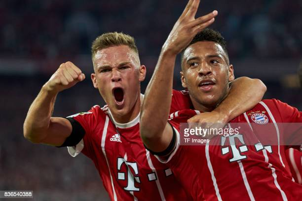 Corentin Tolisso of Muenchen celebrates after scoring his team`s first goal with Joshua Kimmich of Muenchen during the Bundesliga match between FC...