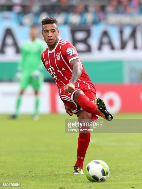 Corentin Tolisso of Muenchen kicks the ball during the DFB Cup first round match between Chemnitzer FC and FC Bayern Muenchen at community4you Arena...