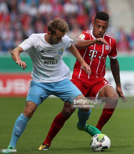Corentin Tolisso of Muenchen vies with Jan Koch of Cottbus during the DFB Cup first round match between Chemnitzer FC and FC Bayern Muenchen at...