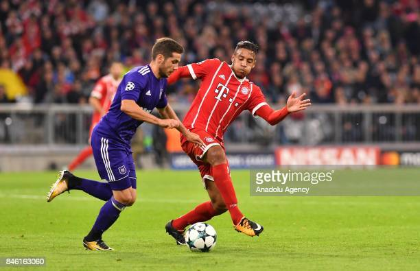 Corentin Tolisso of Munich and Alexandru Chipciu of Anderlecht vie for the ball during the UEFA Champions League match between FC Bayern Munich and...