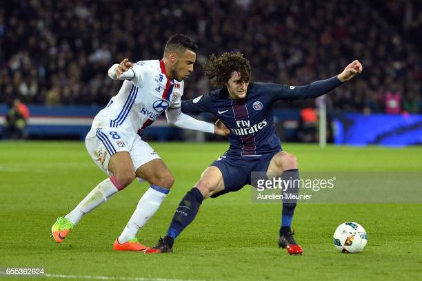 Corentin Tolisso of Olympique Lyonnais and Adrien Rabiot of Paris SaintGermain fight for the ball during the French Ligue 1 match between Paris Saint...