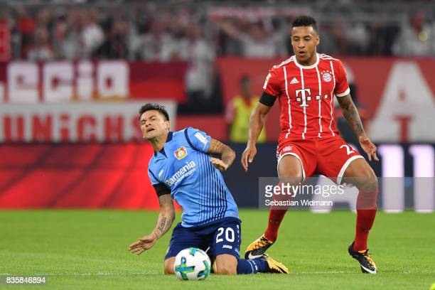 Corentin Tolissoof FC Bayern Muenchen and Charles Aranguiz of Bayer Leverkusen compete for the ball during the Bundesliga match between FC Bayern...