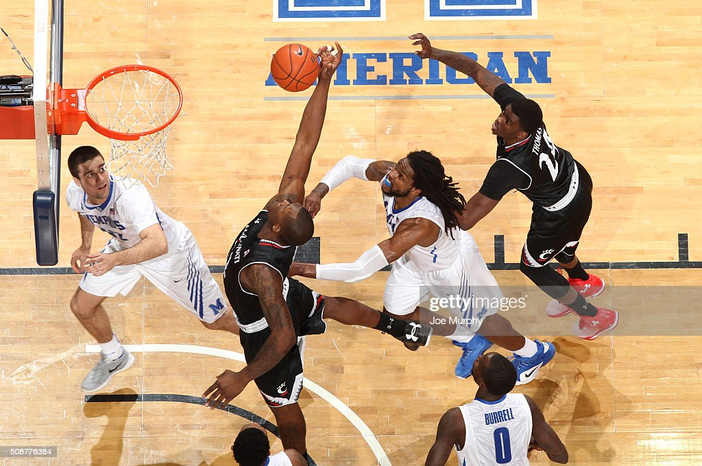 Coreontae DeBerry #22 of the Cincinnati Bearcats jumps for a rebound against Shaq Goodwin #2 of the Memphis Tigers on February 6, 2016 at FedExForum in Memphis. Memphis defeated Cincinnati 63-59.