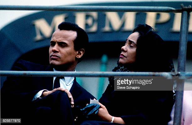 Coretta Scott King and Harry Belafonte sit on a platform outside Memphis City Hall during a threehour rally which followed a memorial march in...