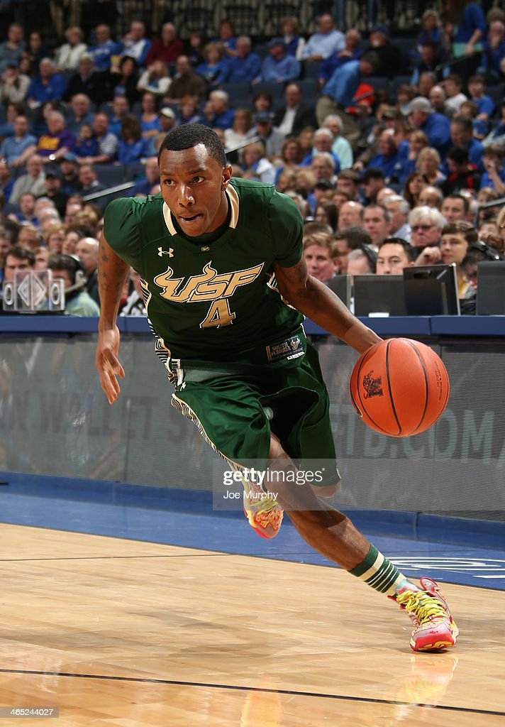 Corey Allen Jr. #4 of the USF Bulls drives with the ball against the Memphis Tigers on January 26, 2014 at FedExForum in Memphis, Tennessee. Memphis beat South Florida 80-58.