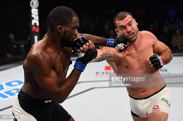 Corey Anderson and Mauricio 'Shogun' Rua of Brazil exchange punches in their light heavyweight bout during the UFC 198 event at Arena da Baixada...
