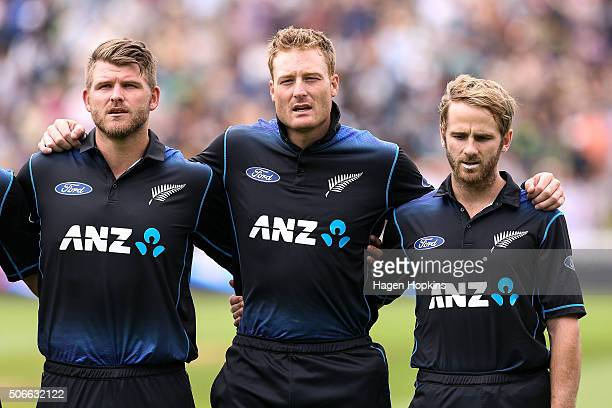 Corey Anderson Martin Guptill and Kane Williamson of New Zealand sing the national anthem during the One Day International match between New Zealand...