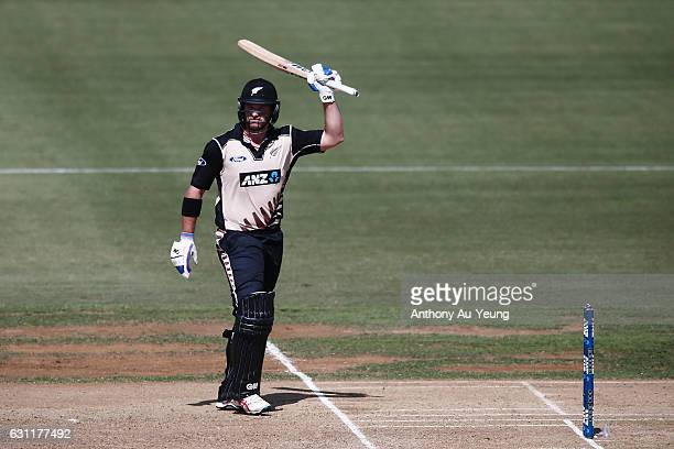 Corey Anderson of New Zealand celebrates scoring a half century during the third Twenty20 International match between New Zealand and Bangladesh at...
