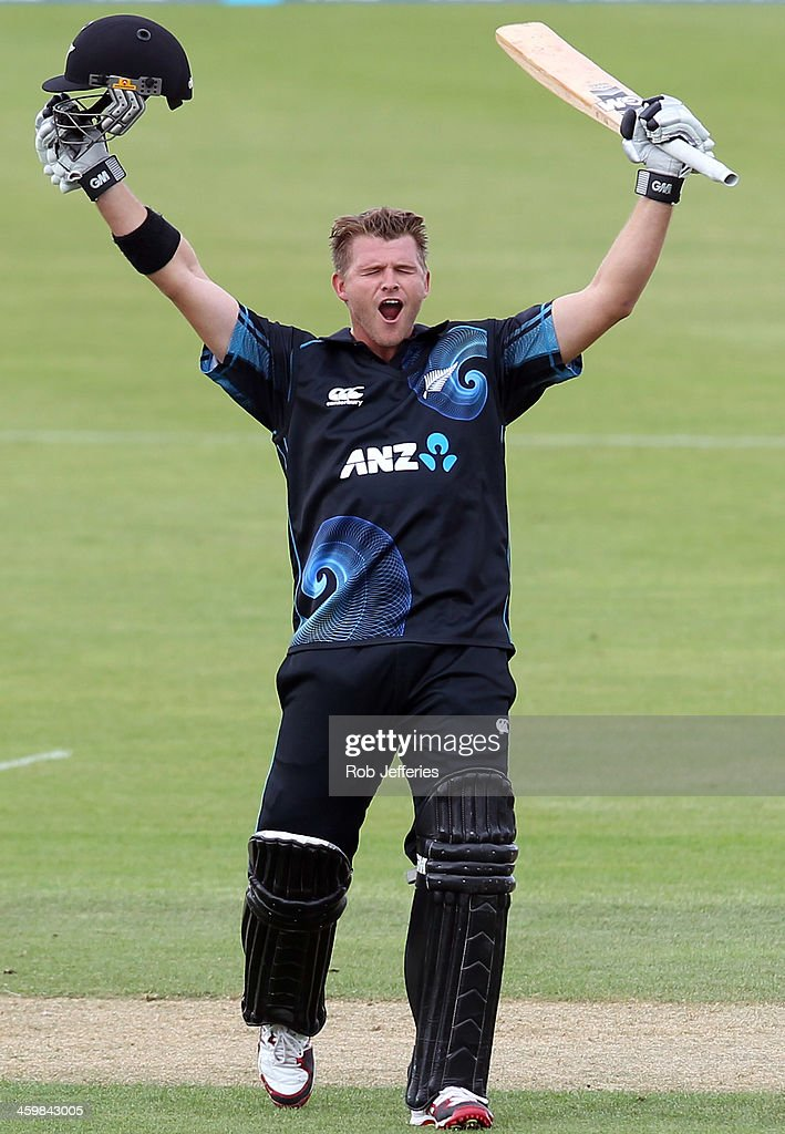 Corey Anderson of New Zealand celebrates scoring the fastest 100 runs in history during game three of the One Day International Series between New...