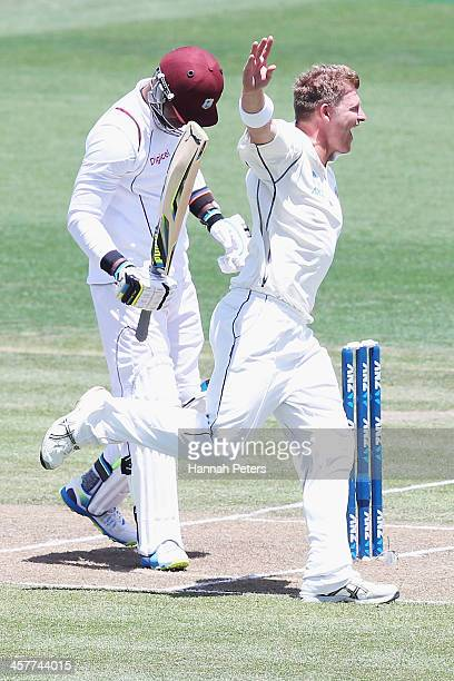 Corey Anderson of New Zealand celebrates the wicket of Marlon Samuels of the West Indies during day one of the Third Test match between New Zealand...