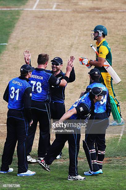 Corey Anderson of New Zealand celebrates the wicket of Rilee Rossouw of South Africa during the One Day International match between New Zealand and...