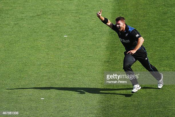 Corey Anderson of New Zealand celebrates the wicket of Rilee Rossouw of South Africa during the 2015 Cricket World Cup Semi Final match between New...