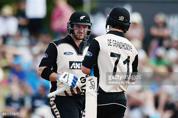 Corey Anderson of New Zealand celebrates with teammate Colin de Grandhomme after their innings during the third Twenty20 International match between...