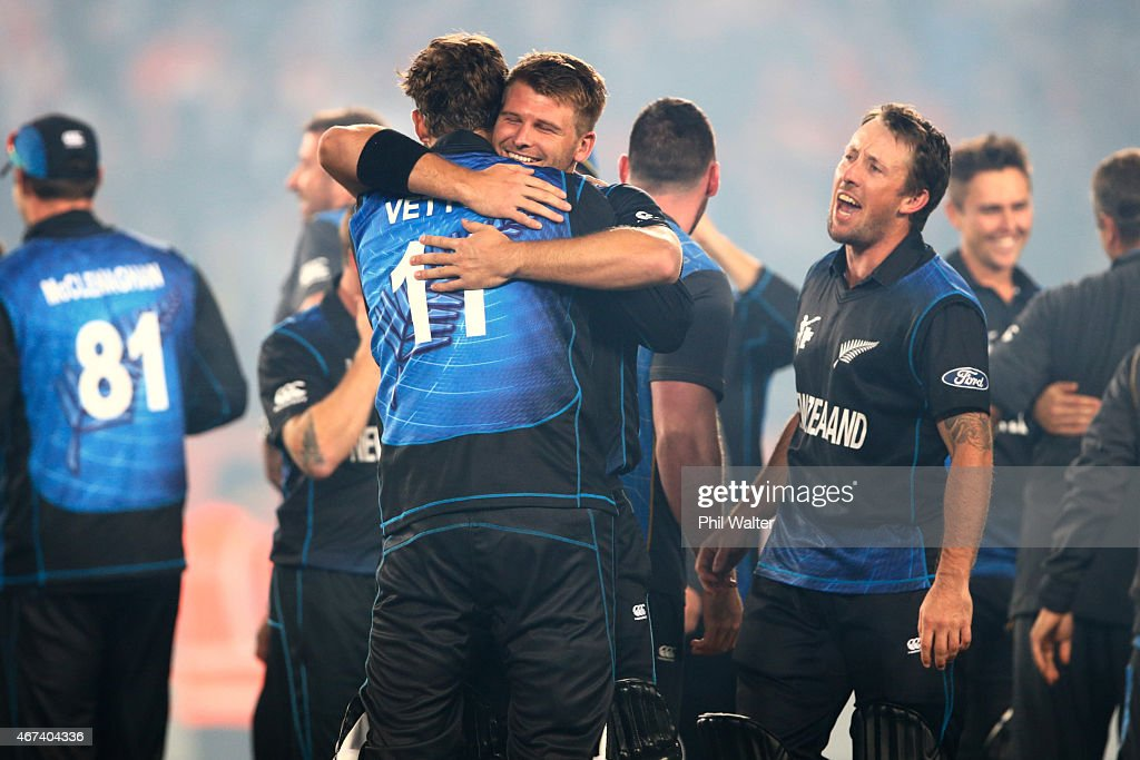 Corey Anderson of New Zealand hugs Daniel Vettori following the 2015 Cricket World Cup Semi Final match between New Zealand and South Africa at Eden Park on March 24, 2015 in Auckland, New Zealand.