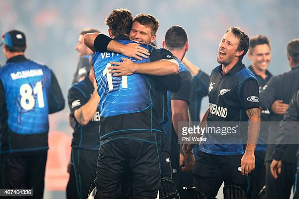 Corey Anderson of New Zealand hugs Daniel Vettori following the 2015 Cricket World Cup Semi Final match between New Zealand and South Africa at Eden...