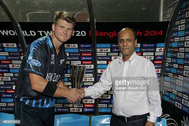 Corey Anderson of New Zealand is presented with man of the match by Shadia Rahman after a thunderstorm and lightning caused the wash out of the...