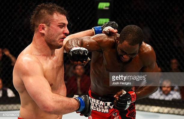 Corey Anderson punches Gian Villante in their light heavyweight bout during the UFC Fight Night event at Prudential Center on April 18 2015 in Newark...