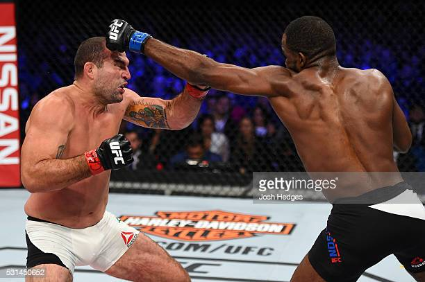 Corey Anderson punches Mauricio 'Shogun' Rua of Brazil in their light heavyweight bout during the UFC 198 event at Arena da Baixada stadium on May 14...