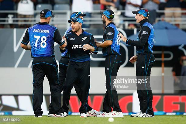 Corey AndersonBrendon McCullum Grant Elliot and Martin Guptill of New Zealand celebrate following the One Day International match between New Zealand...
