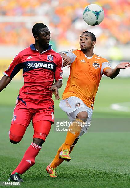 Corey Ashe of the Houston Dynamo and Patrick Nyarko of the Chicago Fire fight for possession of the ball in the second half at BBVA Compass Stadium...