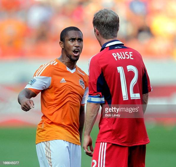 Corey Ashe of the Houston Dynamo has words with Logan Pause of the Chicago Fire after a hard foul at BBVA Compass Stadium on April 14 2013 in Houston...