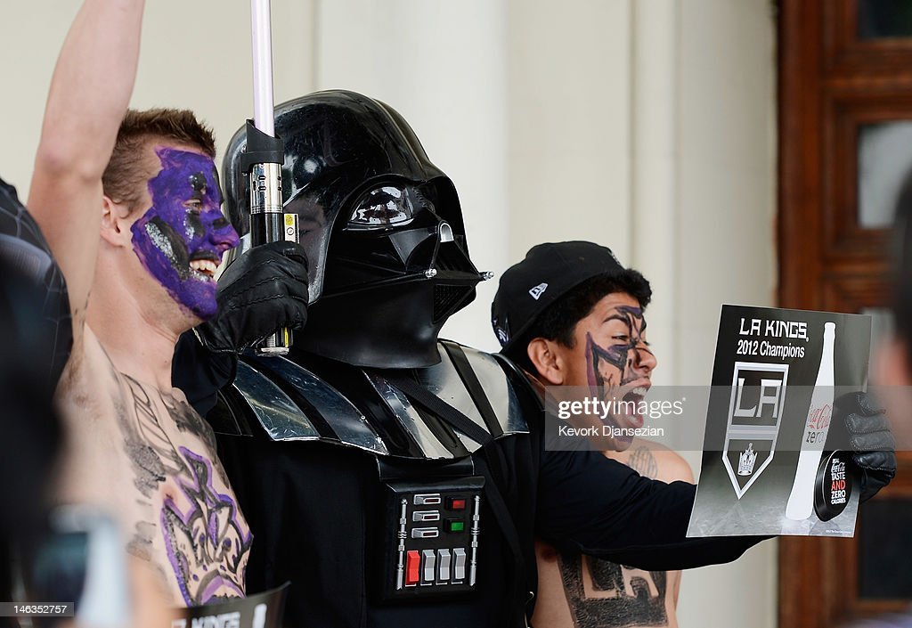 Corey Brankin (L) and Johnny Castellanos (R) from Lancaster, California, get their picture taken with Star Wars character Darth Vader during the Stanley Cup victory parade on June 14, 2012 in Los Angeles, California. The Kings are celebrating their first NHL Championship in the team's 45-year-old franchise history.