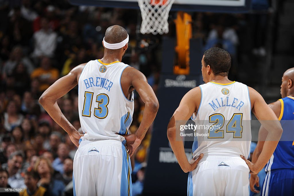 <a gi-track='captionPersonalityLinkClicked' href=/galleries/search?phrase=Corey+Brewer&family=editorial&specificpeople=234749 ng-click='$event.stopPropagation()'>Corey Brewer</a> #13 and <a gi-track='captionPersonalityLinkClicked' href=/galleries/search?phrase=Andre+Miller&family=editorial&specificpeople=201678 ng-click='$event.stopPropagation()'>Andre Miller</a> #24 of the Denver Nuggets stand on the court during the game against the Golden State Warriors in Game Five of the Western Conference Quarterfinals during the 2013 NBA Playoffs on April 30, 2013 at the Pepsi Center in Denver, Colorado.