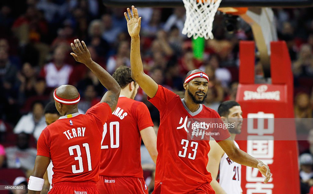 Corey Brewer #33 and Jason Terry #31 of the Houston Rockets celebrate after a basket during their game against the Toronto Raptors at the Toyota Center on February 21, 2015 in Houston, Texas.