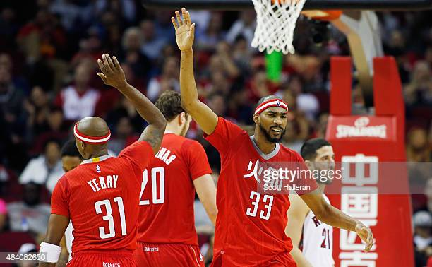 Corey Brewer and Jason Terry of the Houston Rockets celebrate after a basket during their game against the Toronto Raptors at the Toyota Center on...