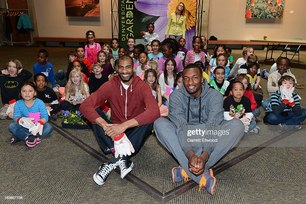 Corey Brewer #13 and Jordan Hamilton #1 of the Denver Nuggets host second graders from Dora Moore K-8 School as part of NBA Cares Green Week to learn about gardening and the importance of protecting the environment on March, 2013 at the Denver Botanical Gardens in Denver, Colorado.