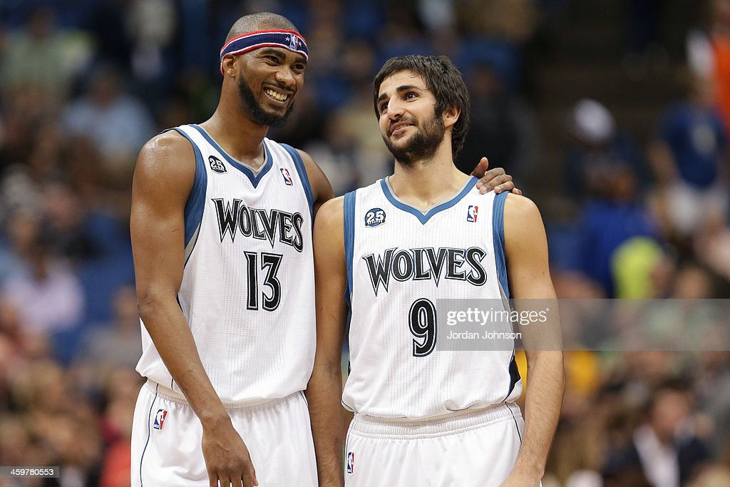 <a gi-track='captionPersonalityLinkClicked' href=/galleries/search?phrase=Corey+Brewer&family=editorial&specificpeople=234749 ng-click='$event.stopPropagation()'>Corey Brewer</a> #13 and <a gi-track='captionPersonalityLinkClicked' href=/galleries/search?phrase=Ricky+Rubio&family=editorial&specificpeople=4028920 ng-click='$event.stopPropagation()'>Ricky Rubio</a> #9 of the Minnesota Timberwolves talk during the game against the Dallas Mavericks on November 8, 2013 at Target Center in Minneapolis, Minnesota.