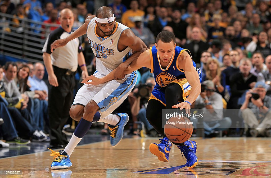 Corey Brewer #13 of the Denver Nuggets and Stephen Curry #30 of the Golden State Warriors vie for a loose ball during Game Five of the Western Conference Quarterfinals of the 2013 NBA Playoffs at the Pepsi Center on April 30, 2013 in Denver, Colorado. The Nuggets defeated the Warriors 107-100.