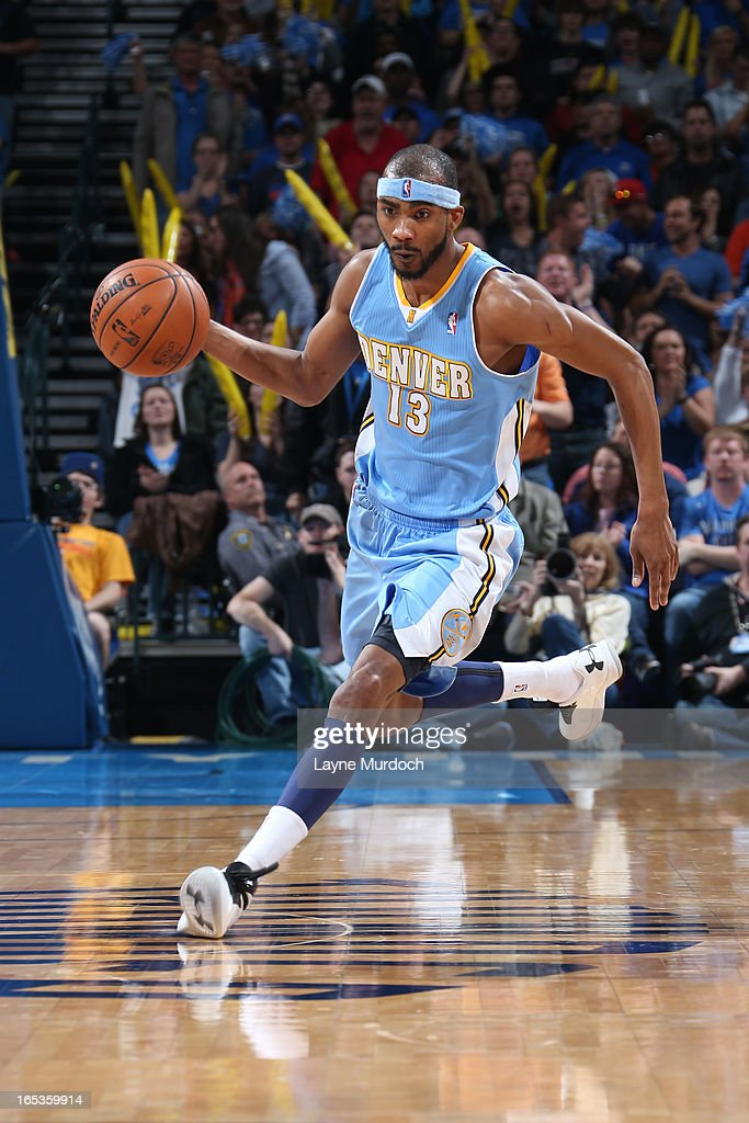 Corey Brewer #13 of the Denver Nuggets brings the ball up court against the Oklahoma City Thunder on March 19, 2013 at the Chesapeake Energy Arena in Oklahoma City, Oklahoma.