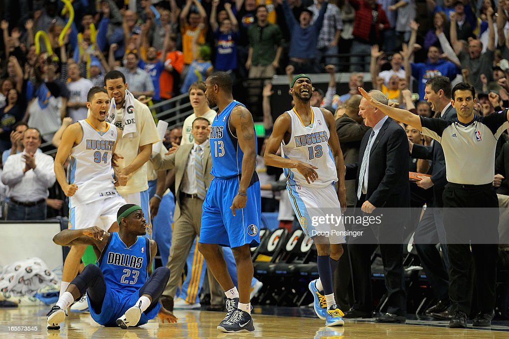 Corey Brewer #13 of the Denver Nuggets celebrates as Anthony Morrow #23 of the Dallas Mavericks reacts after missing a shot in the final second at the Pepsi Center on April 4, 2013 in Denver, Colorado. The Nuggets defeated the Mavericks 95-94.