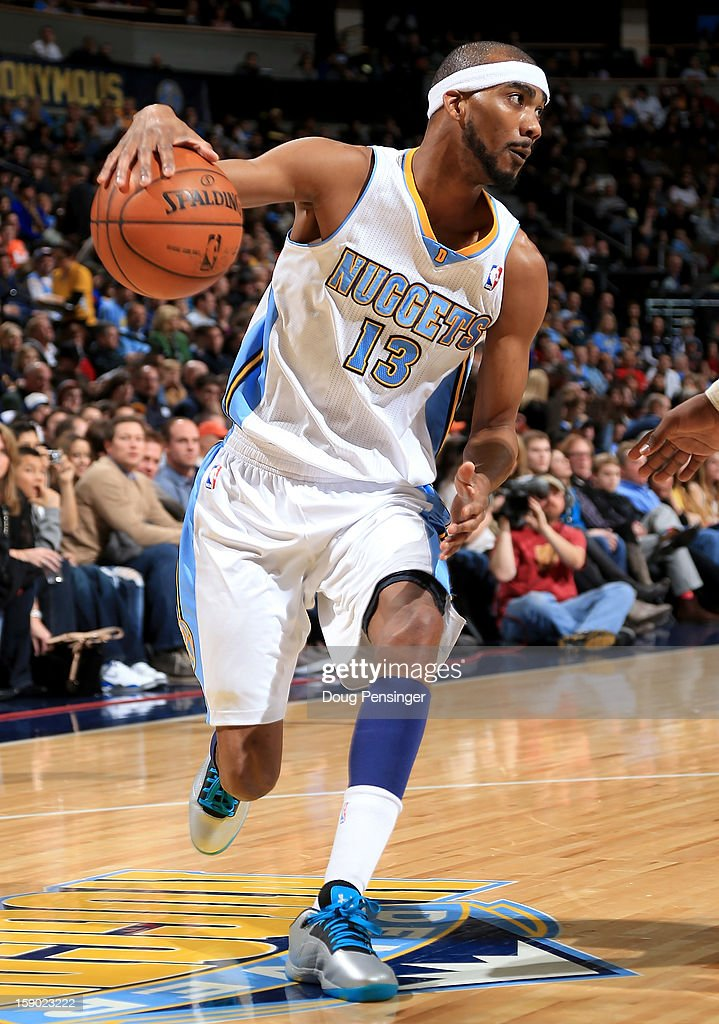 <a gi-track='captionPersonalityLinkClicked' href=/galleries/search?phrase=Corey+Brewer&family=editorial&specificpeople=234749 ng-click='$event.stopPropagation()'>Corey Brewer</a> #13 of the Denver Nuggets controls the ball against the Utah Jazz at the Pepsi Center on January 5, 2013 in Denver, Colorado. The Nuggets defeated the Jazz 110-91.