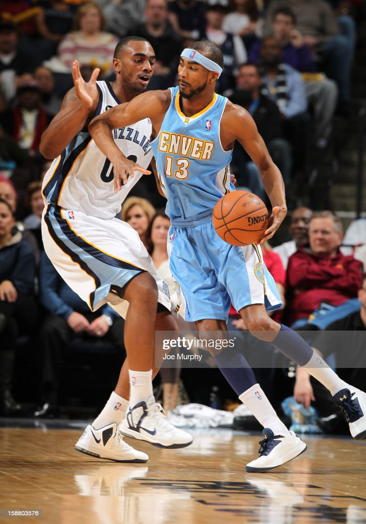 Corey Brewer #13 of the Denver Nuggets drives against Darrell Arthur #00 of the Memphis Grizzlies on December 29, 2012 at FedExForum in Memphis, Tennessee.