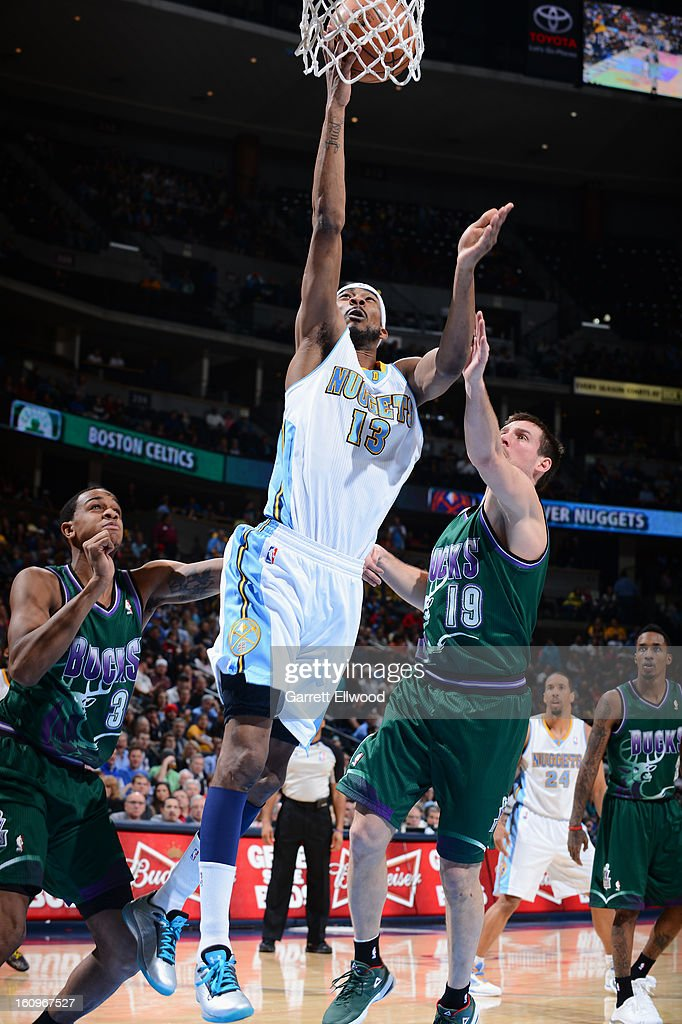 Corey Brewer #13 of the Denver Nuggets drives to the basket against Beno Udrih #19 of the Milwaukee Bucks on February 5, 2013 at the Pepsi Center in Denver, Colorado.