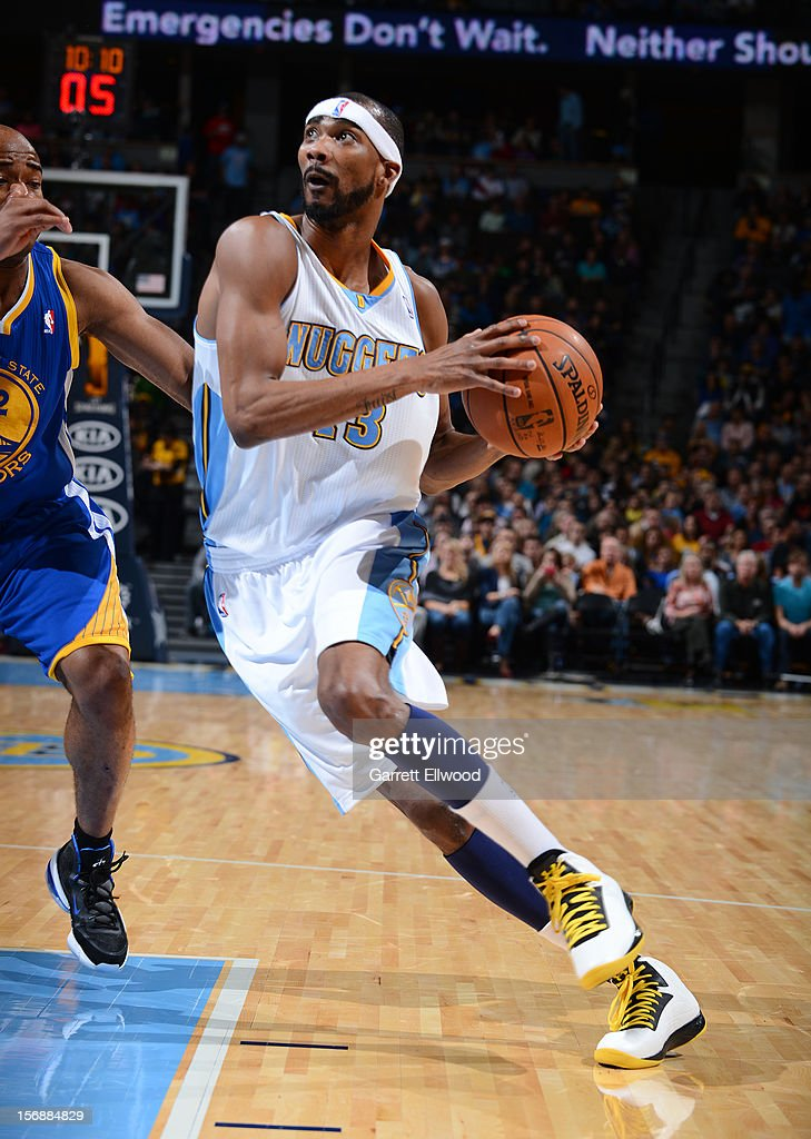 Corey Brewer #13 of the Denver Nuggets drives to the basket against Jarrett Jack #2 of the Golden State Warriors on November 23, 2012 at the Pepsi Center in Denver, Colorado.