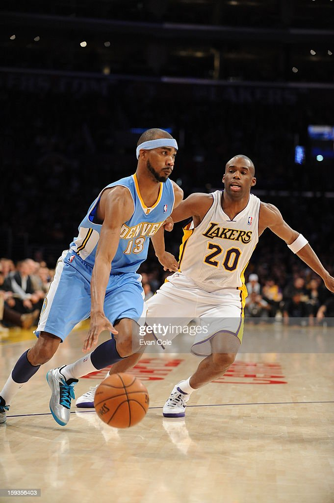 Corey Brewer #13 of the Denver Nuggets drives to the basket against Jodie Meeks #20 of the Los Angeles Lakers at the Staples Center on January 6, 2013 in Los Angeles, California.