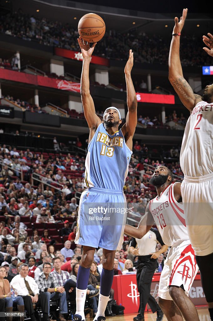 Corey Brewer #13 of the Denver Nuggets drives to the basket against the Houston Rockets on January 23, 2013 at the Toyota Center in Houston, Texas.