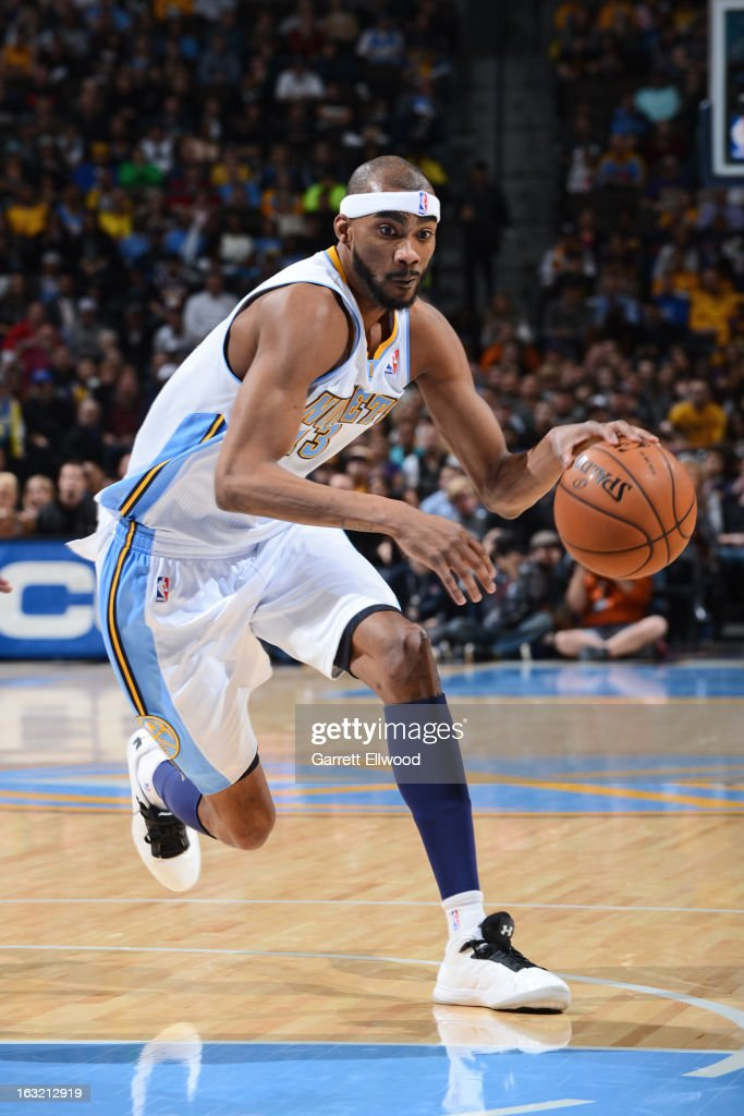 <a gi-track='captionPersonalityLinkClicked' href=/galleries/search?phrase=Corey+Brewer&family=editorial&specificpeople=234749 ng-click='$event.stopPropagation()'>Corey Brewer</a> #13 of the Denver Nuggets drives to the basket against the Los Angeles Lakers on February 25, 2013 at the Pepsi Center in Denver, Colorado.