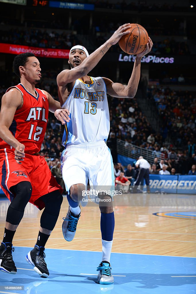 Corey Brewer #13 of the Denver Nuggets drives to the basket against the Atlanta Hawks on March 4, 2013 at the Pepsi Center in Denver, Colorado.