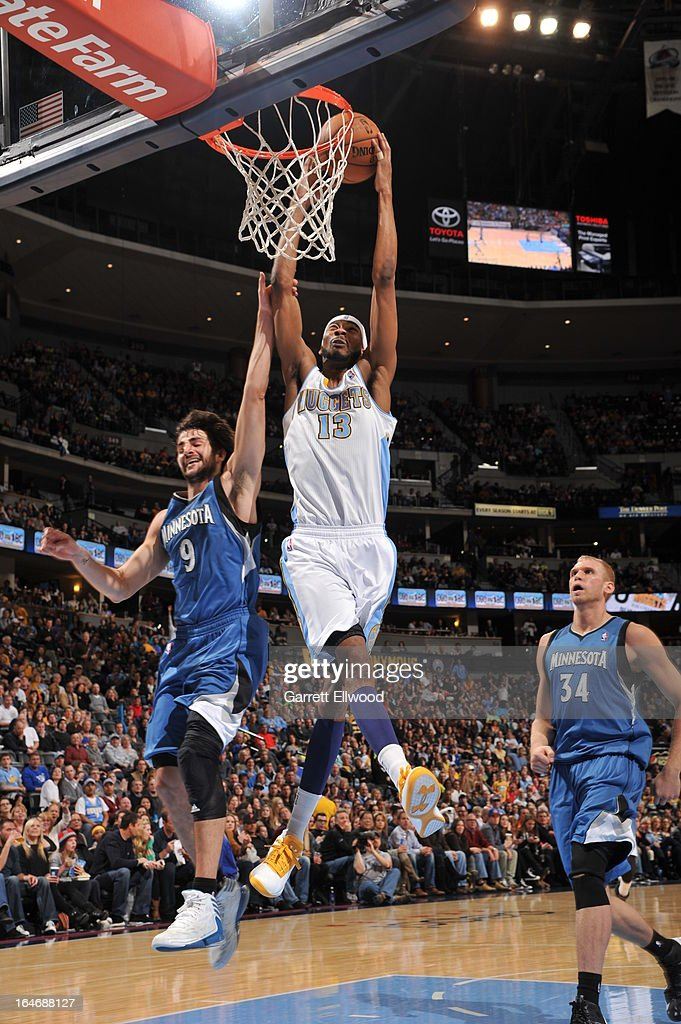 <a gi-track='captionPersonalityLinkClicked' href=/galleries/search?phrase=Corey+Brewer&family=editorial&specificpeople=234749 ng-click='$event.stopPropagation()'>Corey Brewer</a> #13 of the Denver Nuggets dunks the ball against the Minnesota Timberwolves on March 9, 2013 at the Pepsi Center in Denver, Colorado.