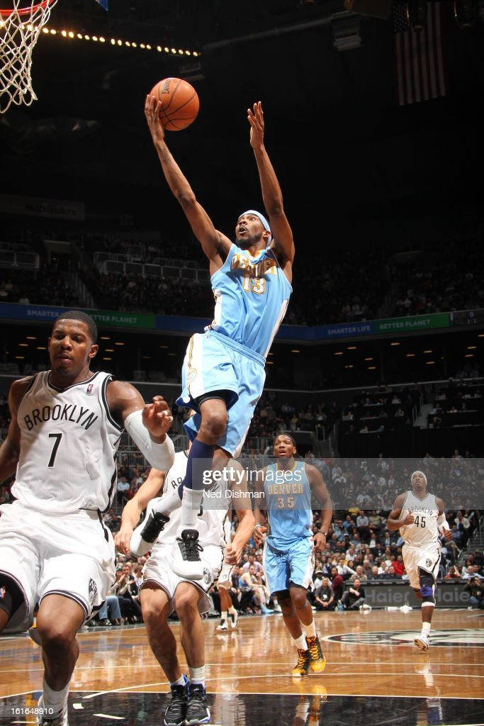 Corey Brewer #13 of the Denver Nuggets finger rolls it in against the Brooklyn Nets at the Barclays Center on February 13, 2013 in the Brooklyn borough of New York City in New York City.