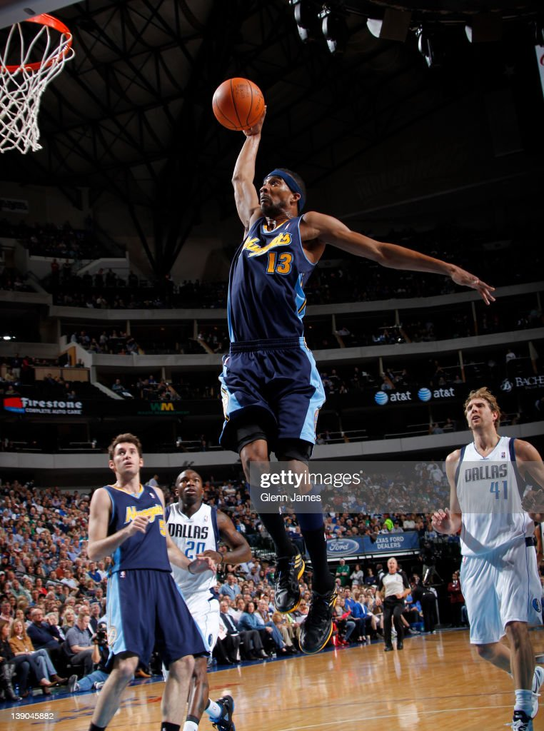 Corey Brewer of the Denver Nuggets flies in for the dunk against the Denver Nuggets on February 15 2012 at the American Airlines Center in Dallas...